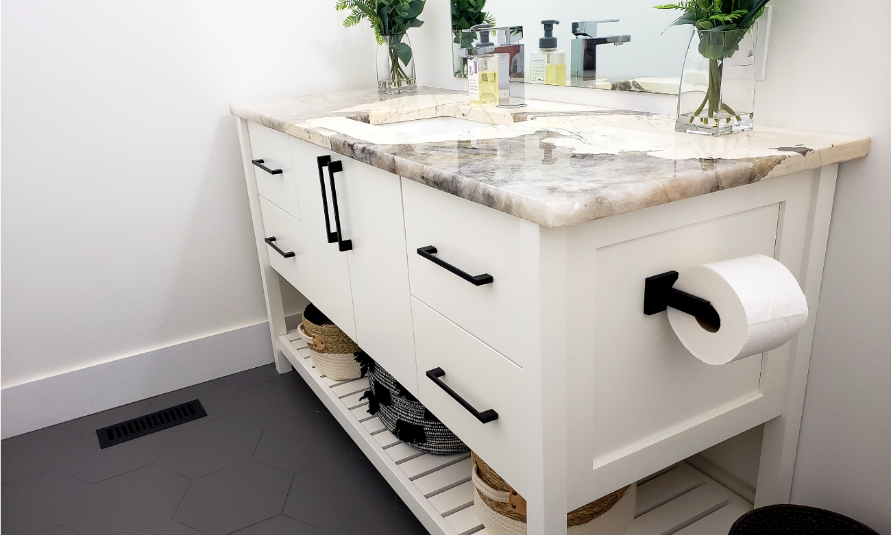 white bathroom vanity with hexagon floor